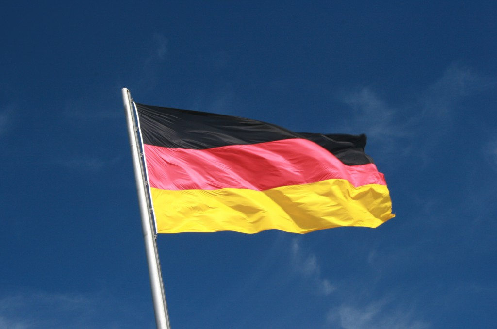 German_Flag_Flying_aganist_a_Blue_Sky